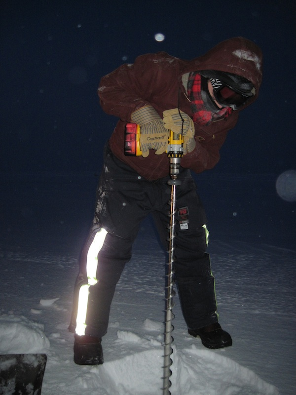 Greg Deemer drilling his first hole in sea ice, Jan, 2011. Photo by Andy Mahoney